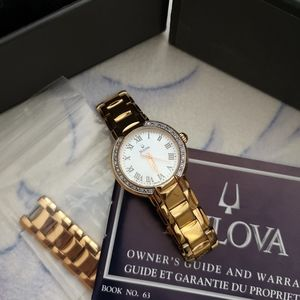 Bulova watch with mother of pearl dial and cystals